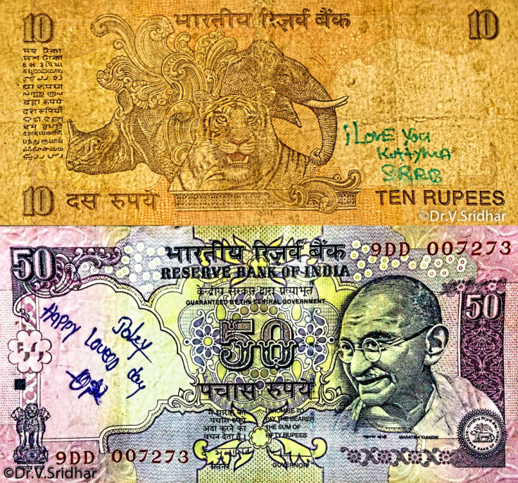 writing on the currency notes,currency notes,Indian rupee